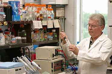 Geneticist Timothy Leathers prepares food-grade enzymes from a cultured strain