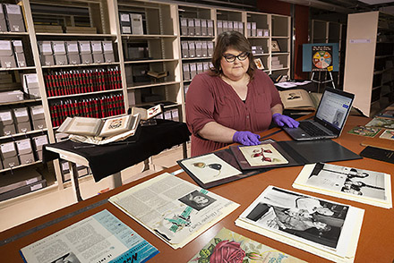 Jamie Flood updating Wikipedia entries about the special collections of Dr. Hazel Stiebling and watercolorist, Deborah Passmore .