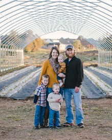 A veteran and his family on their farm