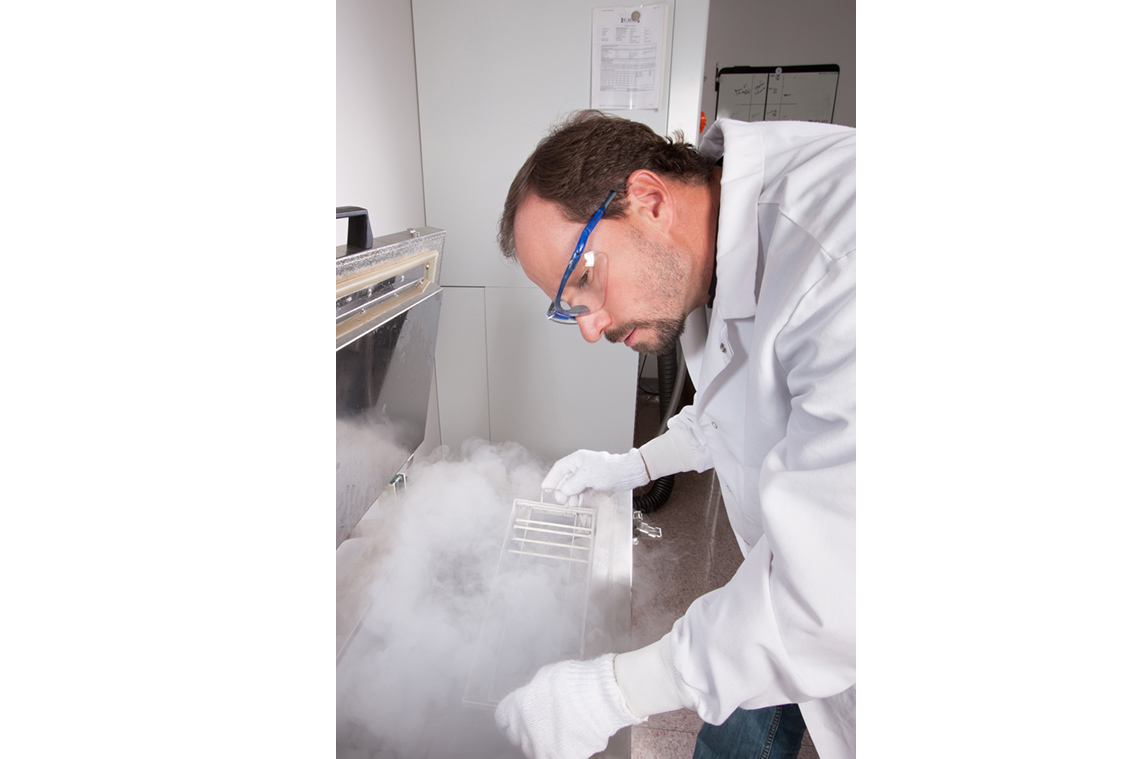 An ARS technician prepares to freeze germplasm samples